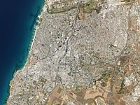This aerial view of the Gush Dan metropolitan area in Israel shows the geometrically planned city of Tel Aviv proper (upper left) as well as Givatayim to the east and some of Bat Yam to the south. Tel Aviv's population is 433,000; the total population of its metropolitan area is 3,785,000.