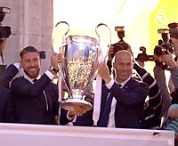 Zidane (right) with Real Madrid captain Sergio Ramos lifting the 2016 UEFA Champions League trophy