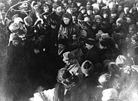 Here, Emma Goldman delivers a eulogy at Peter Kropotkin's funeral procession. Immediately in front of Goldman stands her lifelong comrade Alexander Berkman. Kropotkin's funeral was the occasion of the last great demonstration of anarchists in Moscow—tens of thousands of people poured into the streets to pay their respects.