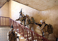 U.S. Marines from 3rd Battalion 3rd Marines clear a house in Al Anbar Governorate.