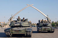 U.S. soldiers at the Hands of Victory monument in Baghdad