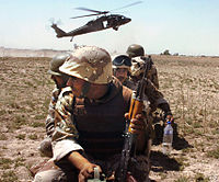 An Iraqi Army unit prepares to board a Task Force Baghdad UH-60 Blackhawk helicopter for a counterinsurgency mission in Baghdad in 2007.
