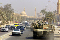 A Marine Corps M1 Abrams tank patrols Baghdad after its fall in 2003.