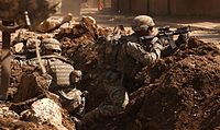 U.S. soldiers take cover during a firefight with insurgents in the Al Doura section of Baghdad, 7 March 2007.