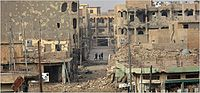 A city street in Ramadi heavily damaged by the fighting in 2006