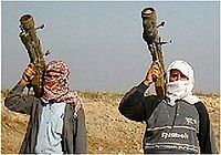 Two insurgents in Iraq with SA-7b and SA-14 MANPADS