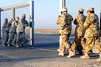 U.S. and Kuwaiti troops closing the gate between Kuwait and Iraq on 18 December 2011