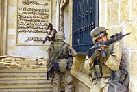 U.S. Marines from 1st Battalion 7th Marines enter a palace during the Fall of Baghdad.