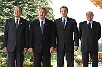 From the left: French President Jacques Chirac, U.S. President George W. Bush, UK Prime Minister Tony Blair and Italian Prime Minister Silvio Berlusconi. Chirac was against the invasion, the other three leaders were in favor.