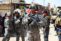 Alabama Army National Guard MP, MSG Schur, during a joint community policing patrol in Basra, 3 April 2010
