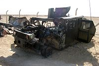 Humvee struck by an improvised explosive device attack in Iraq on 29 September 2004. Staff Sgt. Michael F. Barrett, a military policeman in Marine Wing Support Squadron 373, was severely injured in the attack.