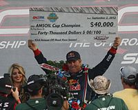 Holding {{USD|40000}} check for winning 2012 AMSOIL Cup