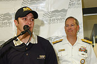 """Rear Adm. Jeff Fowler, right, looks-on as the new driver of the Busch Series """"Life Accelerator,"""" David Stremme, takes questions during a press conference at Memphis Motor Sports Park. Fowler announced that the Navy would extend its partnership with NASCAR and FitzBradshaw for the 2005 season."""
