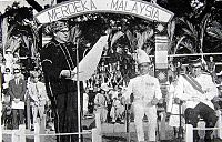Donald Stephens (left) declaring the forming of the Federation of Malaysia at Merdeka Square, Jesselton on 16 September 1963. Together with him is the Deputy Minister of Malaya Abdul Razak (right) and Mustapha Harun (second right).