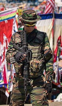 A Malaysian Army soldier armed with Colt M4 standing guard in Sabah east coast as part of the Eastern Sabah Security Command (ESSCOM).