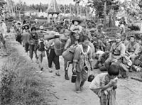 Japanese civilians and soldiers prior to their embarkation to Jesselton after their surrender to the Australian Imperial Force (AIF) in Tawau on 21 October 1945.