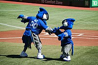Ace and Junior exchange greetings before the game. Ace was the Blue Jays' second mascot, introduced in 2000. Junior is a mascot occasionally seen for Junior Jays day promotions.