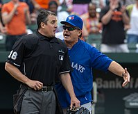 John Gibbons arguing with umpire Mike DiMuro. He returned as the Blue Jays manager prior to the start of the 2013 season.