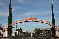 A photograph of the Modesto Arch appears in the album's liner notes, referencing the recurring themes of water and California