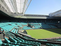 Centre Court at Wimbledon. First played in 1877, the Championships is the oldest tennis tournament in the world.<ref>125 years of Wimbledon: From birth of lawn tennis to modern marvels CNN. Retrieved 28 September 2011</ref>