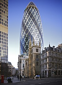 """Modern styles juxtaposed with historic styles; 30 St Mary Axe, also known as """"The Gherkin"""", towers over St Andrew Undershaft."""
