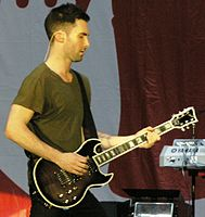 Levine playing the First Act 222 Guitar, which he helped design