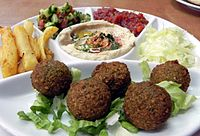 A meal including falafel, hummus, French fries and Israeli salad