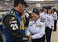 Stremme shaking hands with a member of the Air National Guard at Bristol in 2010, his sponsor that year.