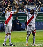 Costa on loan at Rayo Vallecano, celebrating with the goalscorer, Alhassane Bangoura, in a match against Levante, on 19 February 2012.