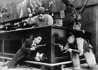 Keaton with Roscoe Arbuckle and Al St. John in still from Out West (1918)