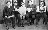 Keaton (center) in 1923 with (from left) writers Joe Mitchell, Clyde Bruckman, Jean Havez, and Eddie Cline