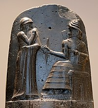 Hammurabi, depicted as receiving his royal insignia from Shamash. Relief on the upper part of the stele of Hammurabi's code of laws.