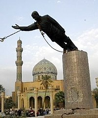 The April 2003 toppling of Saddam Hussein's statue by US Army troops in Firdos Square in Baghdad shortly after the Iraq War invasion.