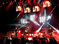 Fall Out Boy performing at a concert during the Monumentour