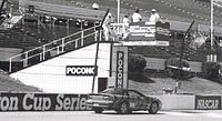 An SCCA T-2 Camaro goes clockwise on the Pocono Raceway's front stretch, 1999