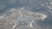 An aerial view of Pocono Raceway taken from a passing jetliner in late March 2014