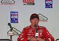 Scott Dixon talks to the press after winning the Pocono IndyCar 400 in 2013.