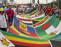 LGBT activists at Cologne Pride carrying a banner with the flags of 72 countries where homosexuality is illegal