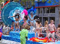 A festive float with costumed dancers at San Francisco Pride 2005