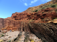 Carboniferous rocks that were folded, uplifted and eroded during the orogeny that completed the formation of the Pangaea supercontinent, before deposition of the overlying Triassic strata, in the Algarve Basin, which marked the start of its break-up