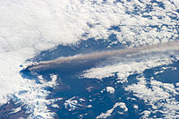 A volcano injecting hot ash into the atmosphere