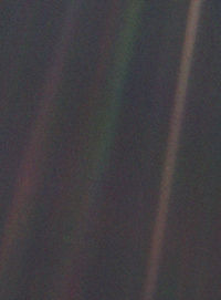 The Pale Blue Dot photo taken in 1990 by the Voyager 1 spacecraft showing Earth (center right) from nearly 4 e9mi away, about 5.9 hours at light speed.