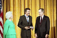 Petty receiving the Medal of Freedom from President George H. W. Bush and First Lady Barbara Bush in 1992