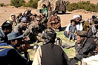 A Specialist of the Massachusetts National Guard from the 182d Infantry with Afghan police