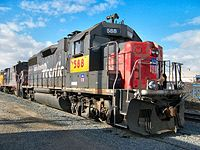 """A former Southern Pacific GP38-2 locomotive renumbered with UP """"patch"""" markings"""