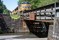 """Union Pacific #5391, approaching bridge at Multnomah Falls Oregon, shows the white-outlined blue """"wings"""" on the nose"""