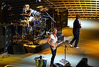 Stewart Copeland (drums), Sting (front), and Andy Summers (far right)