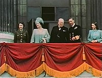 Elizabeth (far left) on the balcony of Buckingham Palace with her family and Winston Churchill on 8 May 1945, Victory in Europe Day