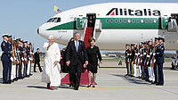 """President George W. Bush walks the red carpet with Pope Benedict XVI. Behind is """"Shepherd One"""" a specially dedicated plane for the Pope belonging to Alitalia. (2008)"""