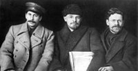 """Joseph Stalin, Vladimir Lenin, and Mikhail Kalinin meeting in 1919. All three of them were """"Old Bolsheviks""""—members of the Bolshevik party before the Russian Revolution of 1917, the first successful socialist revolution in human history."""